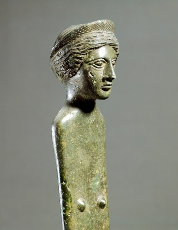Detail of a female deity in bronze, from the Sanctuary of Diana Nemorense, Nemi (Lazio). Etruscan civilization, ca 350 BC.
