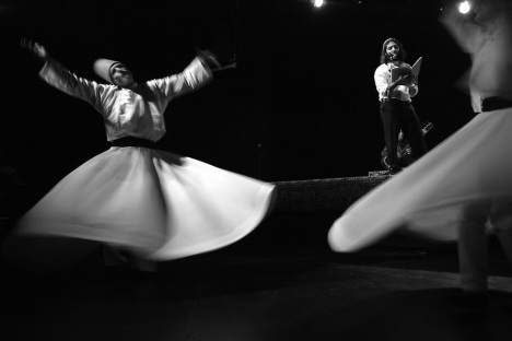 "Raqib Brian Burke, left, and Jane Garland whirl to the poetry of Mevlana Jalaluddin Rumi, while celebrating the Sufi spiritual leader's 800th birthday at the ArtsCenter in Carrboro.  ""Whirling is a form of prayer,"" explains Garland, ""a way of connecting to the divine.  As you become a human prayer wheel, the right hand receives, and the left hand transmits.  You become like a channel of energy so that the divine energy can come through and express itself."""